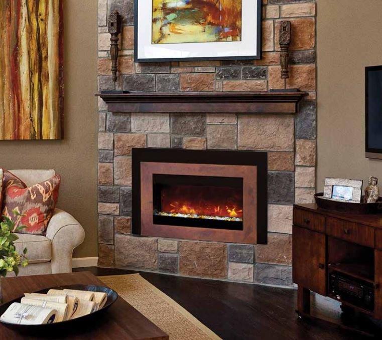 Small electric fireplace insert, available for purchase from Luce's Chimney & Stove Shop in Swanton, OH