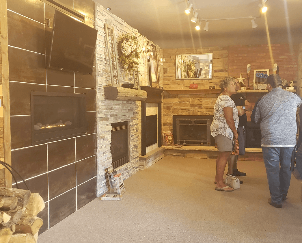 Fireplace and heating stove displays inside Luce's Chimney and Stove Shop, serving Ohio, Michigan and Indiana.
